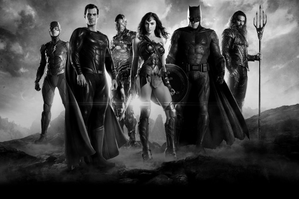 a group of superheroes stand together against a black and white backdrop