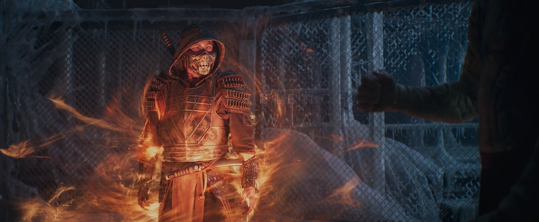 man in ancient armor surrounded by magic orange flames